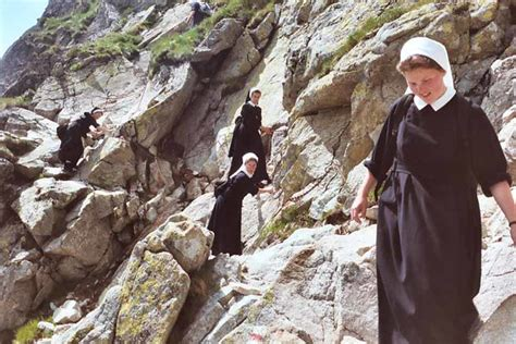 Nuns on a chain-assisted section of Orla Perc path   Flickr