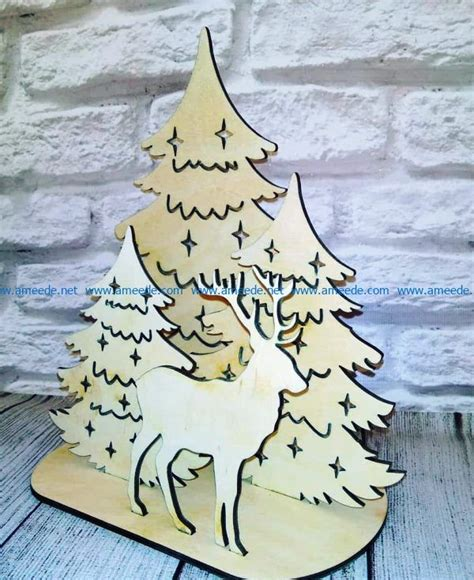 Reindeer and christmas tree file cdr and dxf free vector